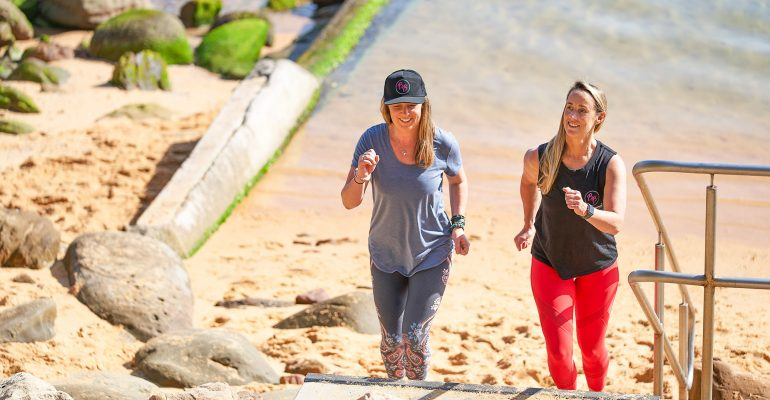 Kate and client walking at the beach
