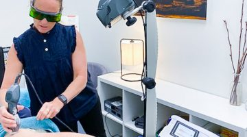 Kate performing MLS Laser Therapy